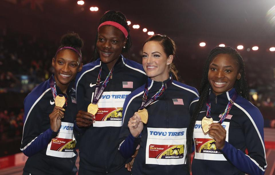 United States' Quanera Hayes, Shakima Wimbley, Georganne Moline and Courtney Ovolo, from left, show off their gold medals for the women's 4x400-meter final at the World Athletics Indoor Championships in Birmingham, Britain, Sunday, March 4, 2018. (AP Photo/Alastair Grant)