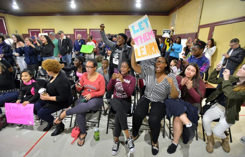 Demonstrators chant during a meeting of the Mystic Valley Regional Charter School Board in support of the young Black women who've been disciplined for their hair styles. The Board of Trustees then went into executive session. Josh Reynolds for The Boston Globe (Metro, ) 5/21/17