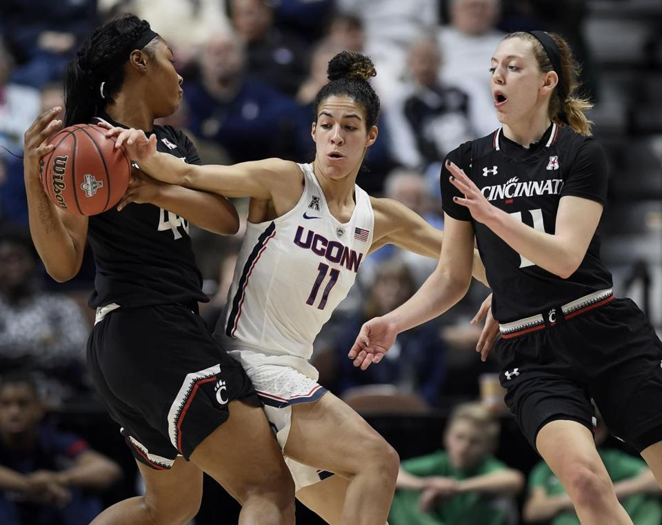 Cincinnati's Andeija Puckett, left, looks to pass to Sam Rodgers, right, under pressure from Connecticut's Kia Nurse during the first half of an NCAA college basketball game in the American Athletic Conference tournament semifinals at Mohegan Sun Arena, Monday, March 5, 2018, in Uncasville, Conn. (AP Photo/Jessica Hill)