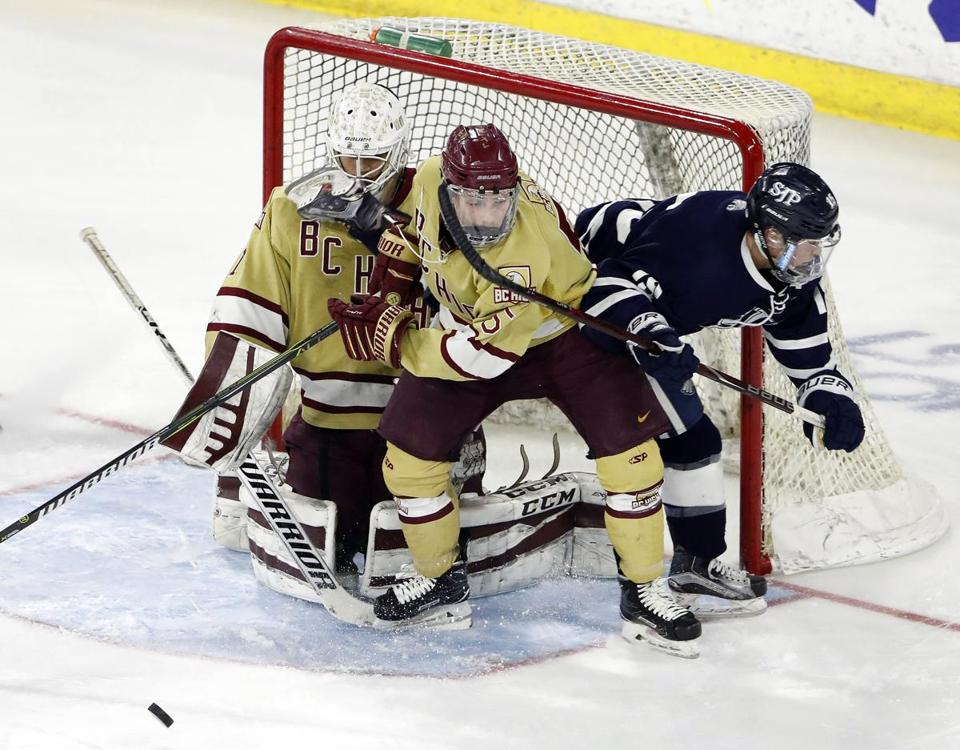 St. John's Prep's Ryan Farrow (right) was outnumbered by BC High goaltender Luke Garrity and Andrew McDonough.