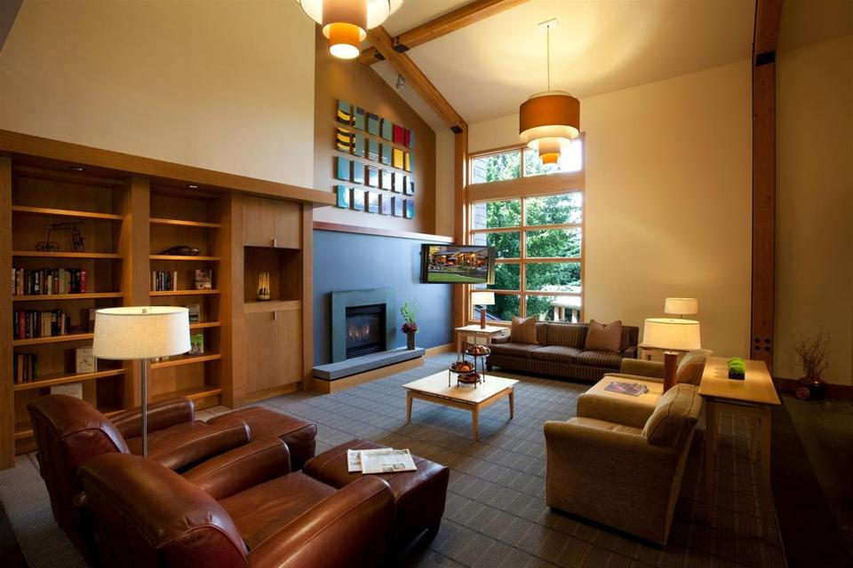 Each of Cedarbrook Lodge's guest-only communal living rooms has a gas fireplace, vaulted ceiling, original art work, and big sofas and chairs.