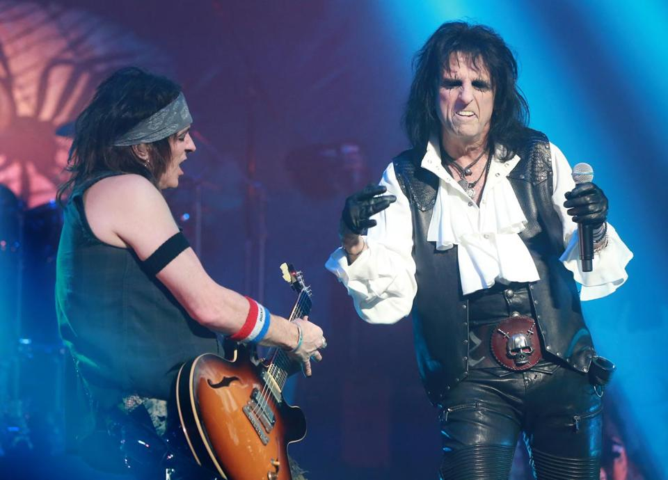 Alice Cooper (right) jamming with bandmate Ryan Roxie while in concert at the Wang Theatre.
