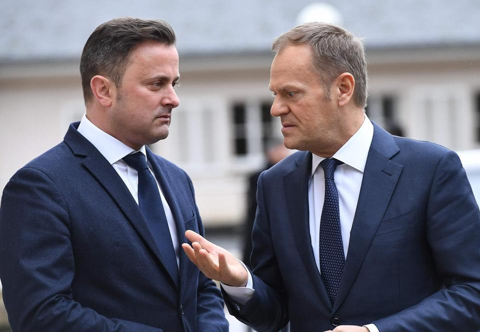 "European Council President Donald Tusk (R) is welcomed by Luxembourg's Prime Minister Xavier Bettel prior to their meeting in Senningen on March 7, 2018. Tusk said EU does not want to ""build a wall"" with Britain as it leaves the bloc. ""On the contrary the UK will be our closest neighbour and we want to remain friends and partners,"" Tusk told the press conference. / AFP PHOTO / EMMANUEL DUNANDEMMANUEL DUNAND/AFP/Getty Images"