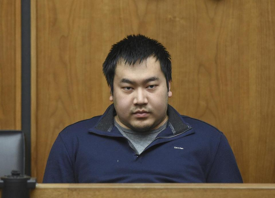 Jeffrey Yao is brought into Woburn District Court, Monday, Feb. 26, 2018 in Woburn, Mass. Yao is arraigned on murder charges and attempted murder after allegedly stabbing a woman to death and attempting to stab a man to death in the Winchester Public Library. (Faith Ninivaggi/The Boston Herald via AP, Pool)