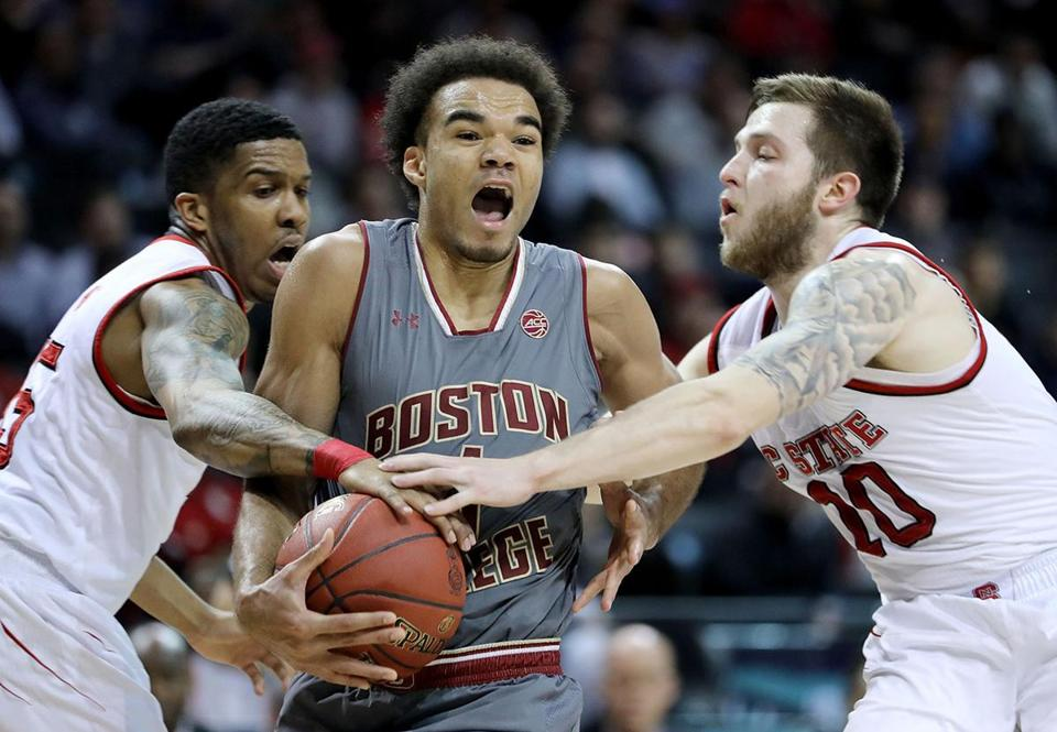 NEW YORK, NY - MARCH 07: Jerome Robinson #1 of the Boston College Eagles works against Braxton Beverly #10 and Sam Hunt #15 of the North Carolina State Wolfpack in the first half during the second round of the ACC Men's Basketball Tournament at Barclays Center on March 7, 2018 in New York City. (Photo by Abbie Parr/Getty Images)