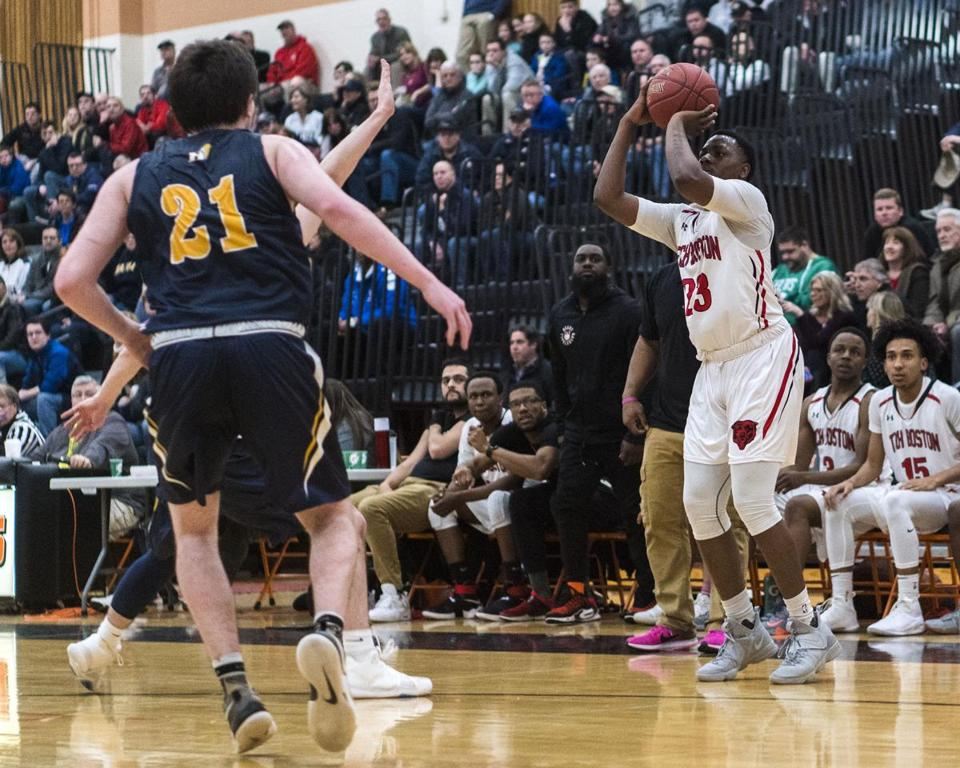 8.4.1207855513_Sports_08schhoop Tech Boston forward Shamar Moore (23) fires up a three against Hanover during the Division 2 South semifinal round boys' basketball game won by Tech Boston 58-47 at Taunton High School in Taunton, Mass., Wednesday, March. 7, 2018. (Robert E. Klein for the Boston Globe)