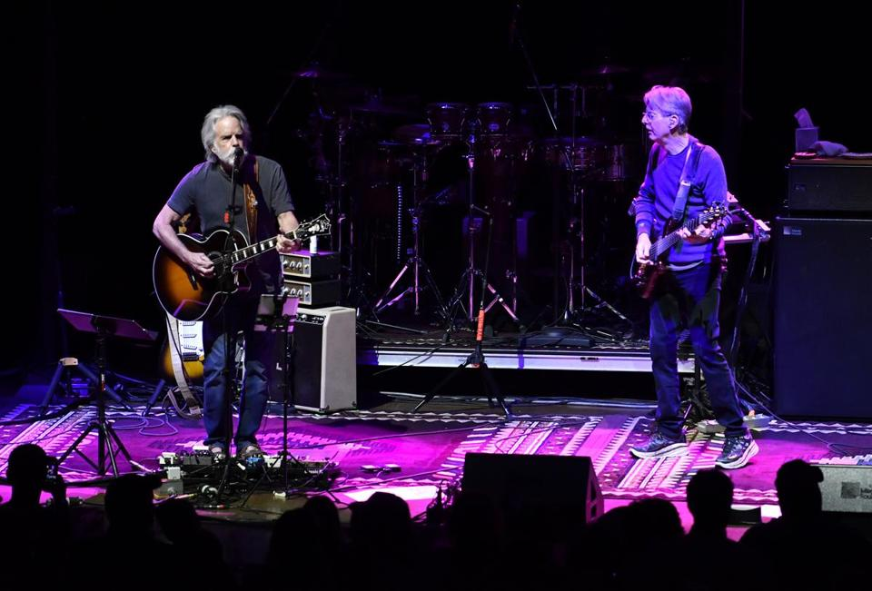 Bob Weir (left) and Phil Lesh in concert.