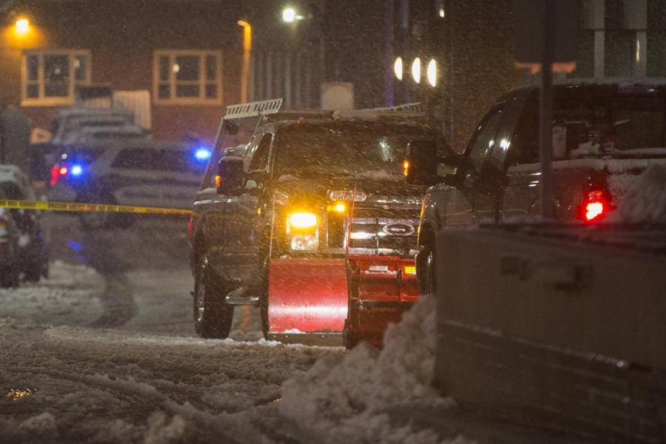 Boston Police investigate the scene where a snow plow hit a woman near Tufts Medical Center on Wednesday night.