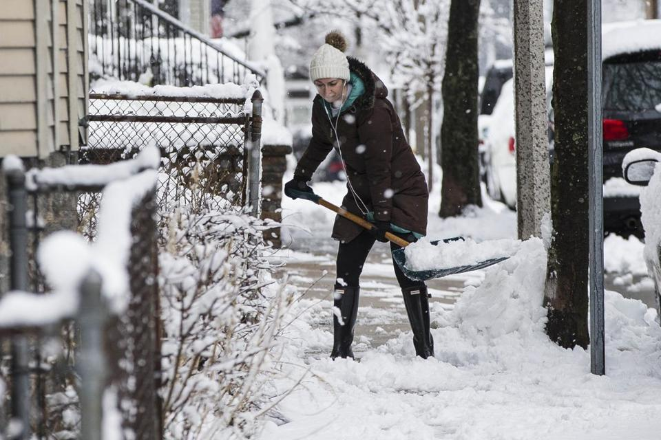 A woman shoveled a walkway in Savin Hill.