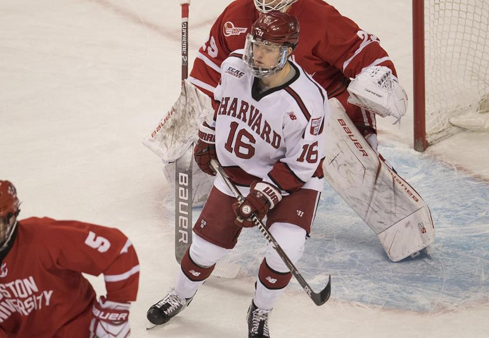 Boston, MA - 2/5/2018 - Harvard Univ. #16 Ryan Donato attempt to limit the view for BU Goalie #29 Jake Oettinger. BU #5 Cam Crotty (bottom left) 66th Beanpot tournament (John Cetrino for The Boston Globe) SPORTS Barbara Matson (matson)