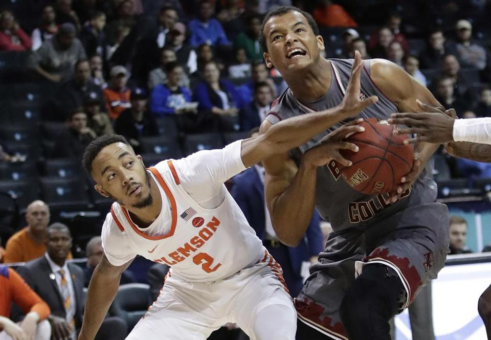 Boston College's Steffon Mitchell (41) looks toward the basket as Clemson's Marcquise Reed (2) defends during the first half of an NCAA college basketball game in the quarterfinal round of the Atlantic Coast Conference tournament Thursday, March 8, 2018, in New York. (AP Photo/Frank Franklin II)