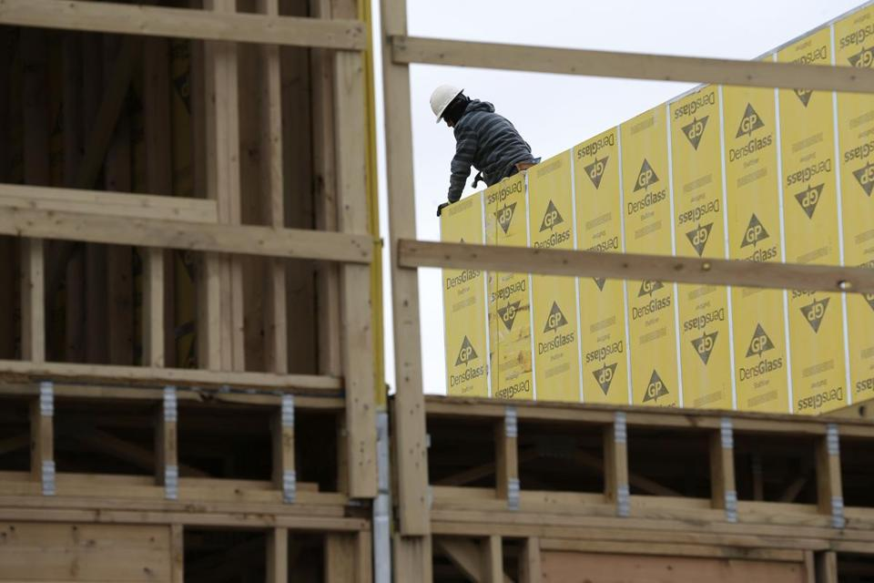 FILE- In this Monday, Feb. 26, 2018, photo, work continues on a new development in Fair Lawn, N.J. On Friday, March 9, the Labor Department reports its job and wages data for February. (AP Photo/Seth Wenig, File)