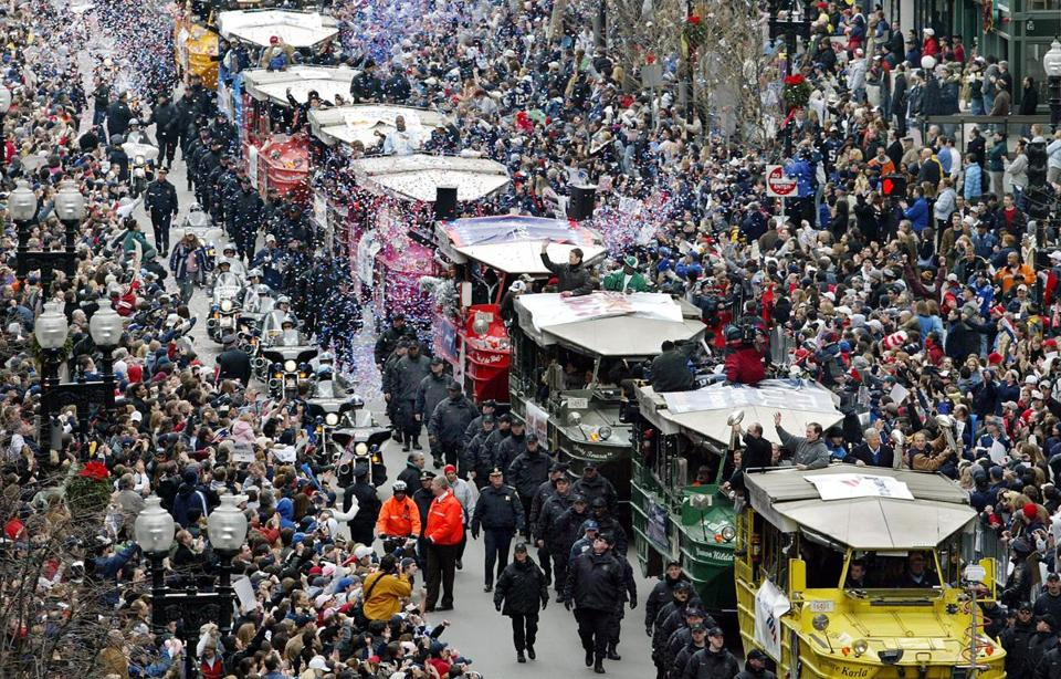 A rolling rally made its way through the streets of Boston in February 2005. More than 40 players from the Patriots' first three championship team are part of the lawsuit.