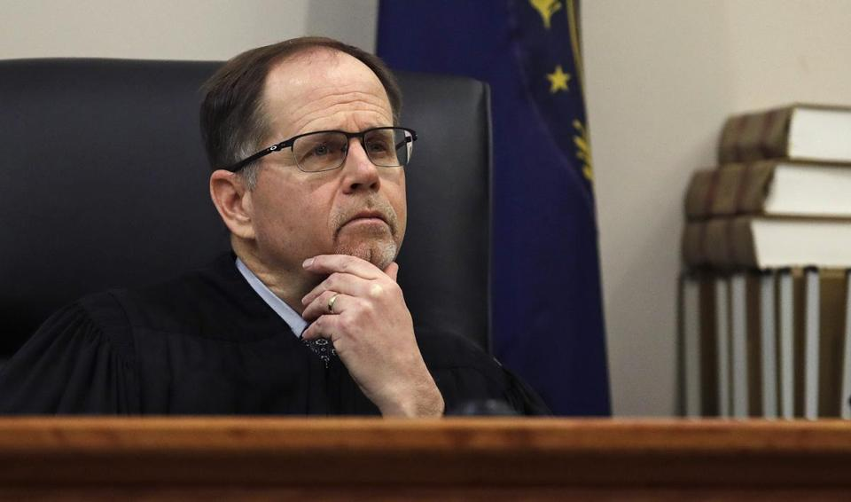 Judge Charles Temple listened during a proceeding in the Powerball privacy case.