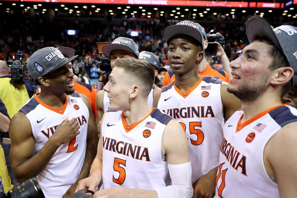 NEW YORK, NY - MARCH 10: The Virginia Cavaliers celebrate after defeating the North Carolina Tar Heels 71-63 during the championship game of the 2018 ACC Men's Basketball Tournament at Barclays Center on March 10, 2018 in the Brooklyn borough of New York City. (Photo by Abbie Parr/Getty Images)