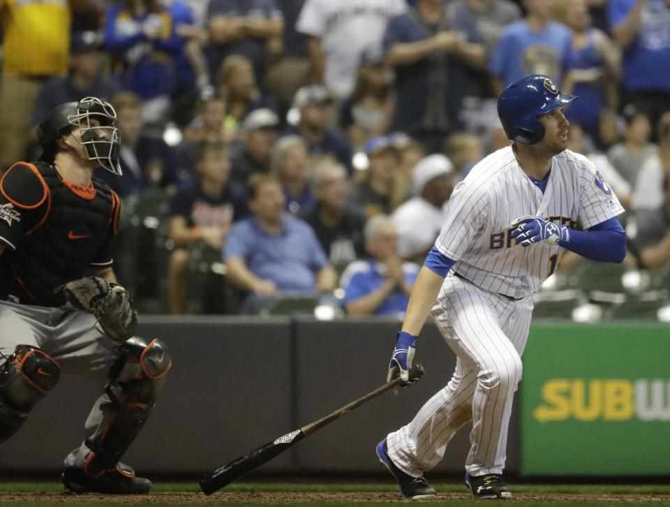 Milwaukee Brewers' Neil Walker hits a grand slam during the eighth inning of a baseball game against the Miami Marlins Friday, Sept. 15, 2017, in Milwaukee. (AP Photo/Morry Gash)