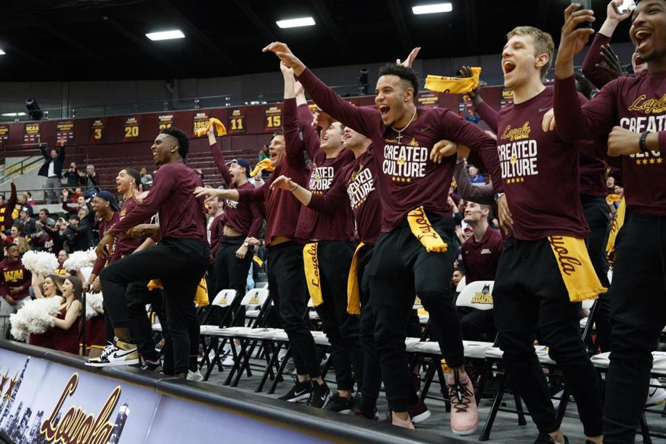 Loyola men's basketball players celebrate during the NCAA Tournament selection show.