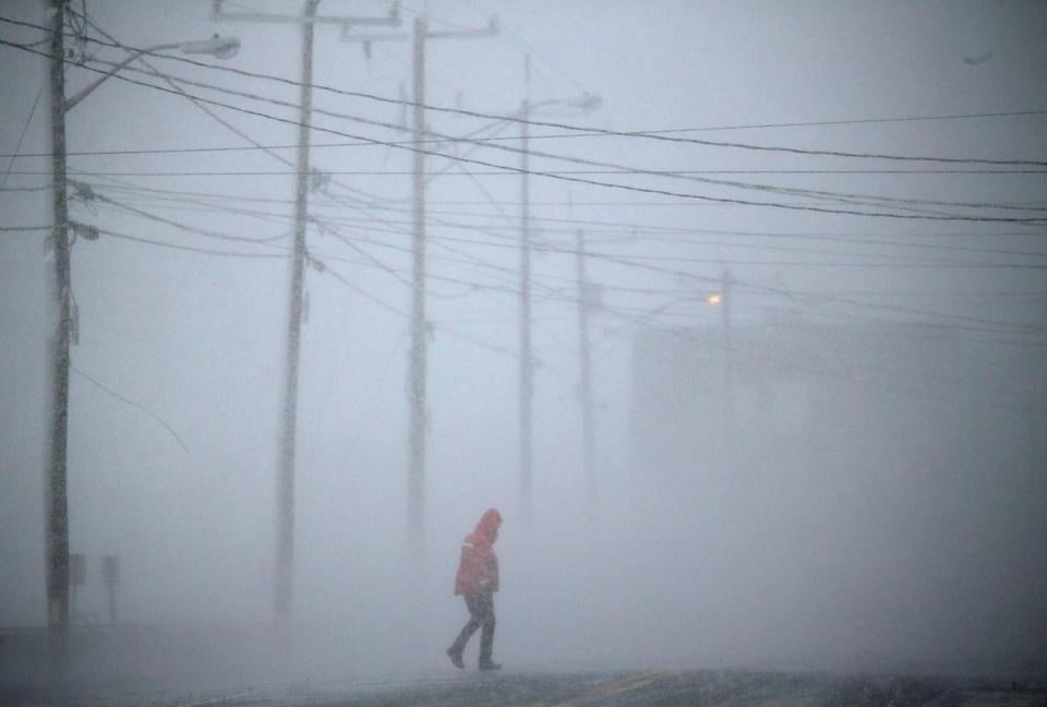 Marshfield, MA- March 13, 2018: A pedestrian walks along the Ocean Street seawall in Marshfield, MA on March 13, 2018. Blizzard conditions are expected in some areas Tuesday as a major nor'easter sweeps into Massachusetts, whipping up high winds and dumping up to 2 feet of snow on a region weary — and wary — after two other powerful storms in as many weeks. (Globe staff photo / Craig F. Walker) section: metro reporter: snow storm nor'easter blizzard