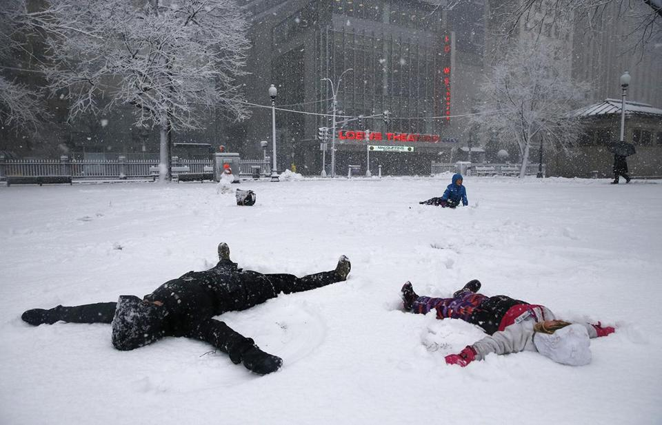A woman and her daughter made snow angels on Boston Common Tuesday.