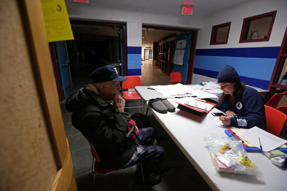 Leon Burke, 89, of Buzzards Bay, was checked into a shelter at Sandwich High School by Hannah Bourassa of Americorps Cape Cod after losing power in his home Tuesday morning.