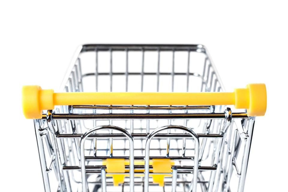 Empty metal shopping basket on wheels with yellow handle isolated on white background, consumer basket, food cart, back closeup view