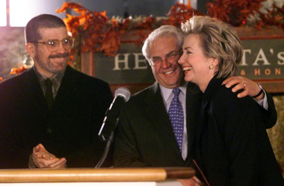 David Mamet applauded as Hillary Clinton was hugged by Friedman.