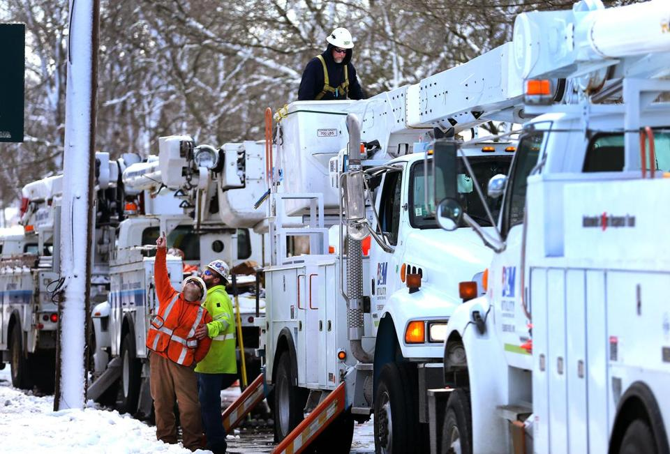 Electric utility trucks from New York worked on power lines on Main Street in Orleans Wednesday.