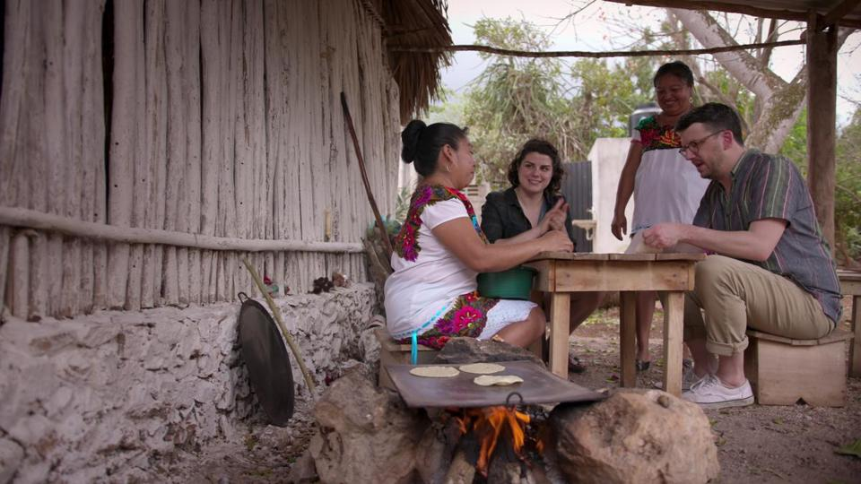 Food writer Peter Meehan (far right) and chef Rosio Sanchez (second from left) make tortillas with chefs in Yaxunah, Mexico.