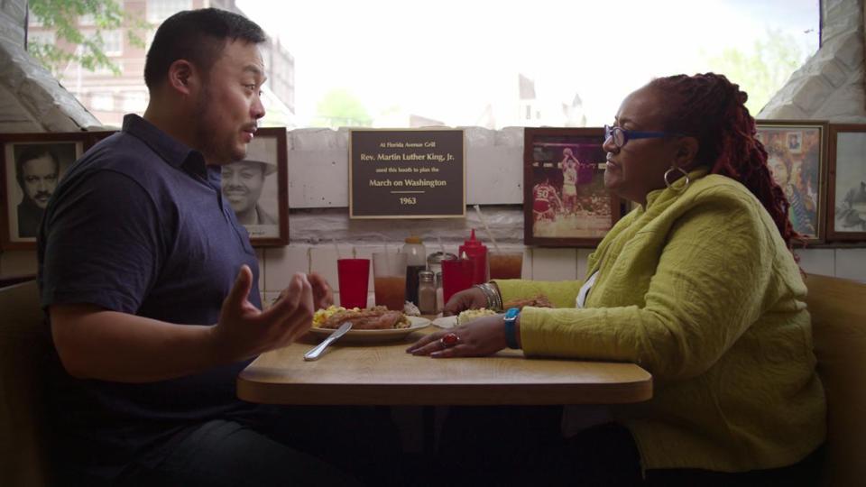 David Chang with University of Maryland professor Psyche Williams-Forson in a booth once used by Martin Luther King Jr.