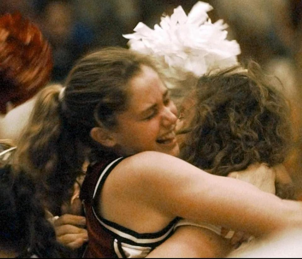 Harvard's Sarah Russell, left, hugs Laela Sturdy after Harvard beat Stanford 71-67 in the first round of the NCAA women's basketball tournemant Saturday, March 14, 1998 in Stanford, Calif. Harvard made history by becoming the first 16th seed in NCAA basketball history to eliminate a No. 1 seed. (AP Photo/Susan Ragan) -- Library Tag 03182006 Sports