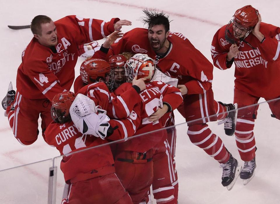 Boston, MA - 3/17/2018 - (3rd period) Boston University Terriers goaltender Jake Oettinger (29) is at the center of the celebration as time ran out on Providence College as BU took a 2-0 win score to win the Hockey East championship at TD Garden. Boston University vs. Providence College in the Hockey East Championship game at TD Garden. - (Barry Chin/Globe Staff), Section: Sports, Reporter: Globe Correspondent, Topic: 18BU-PC Hockey, LOID: 8.4.1303149976.