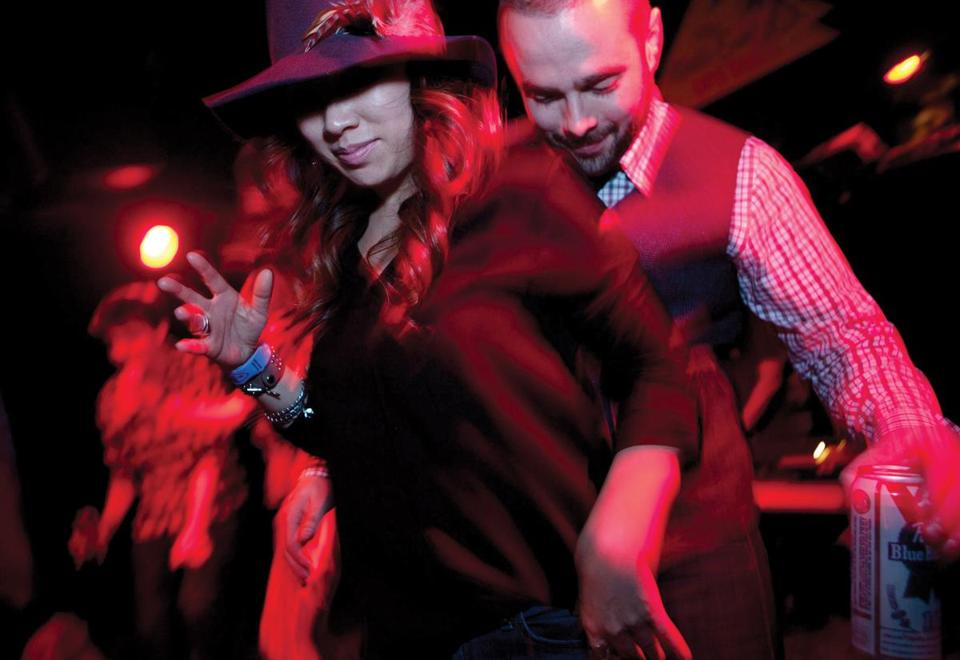 Cambridge, MA -- 03/22//14 -- Michelle Bolesta of Boston and Eric Kukieza of Philadelphia, PA danced to soul and funk DJ's at the Soulelujah dance party at ZuZu on March 22, 2014 in Cambridge, Massachusetts. (Kayana Szymczak for The Boston Globe)