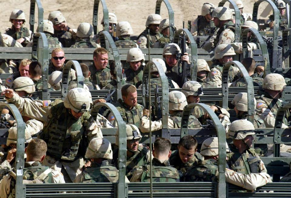 Soldiers of the 3rd Battalion, 124th Infantry Regiment, based in Florida, prepare to go back to their barracks after receiving the combat infantry badges at the awarding ceremony Friday July 11, 2003 in Baghdad, Iraq. The U.S. military on Friday handed out hundreds of combat infantryman badges to soldiers who took part in the fight for Baghdad, the first time since the Korean War that the medals have been presented to American reservists. (AP Photo/Bullit Marquez) -- Library Tag 07122003 National-Foreign