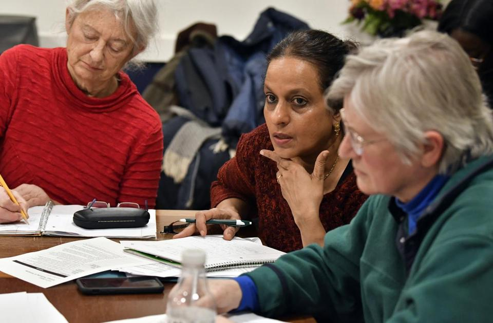 Annie Athyal (center), a case manager, spoke at a group session.
