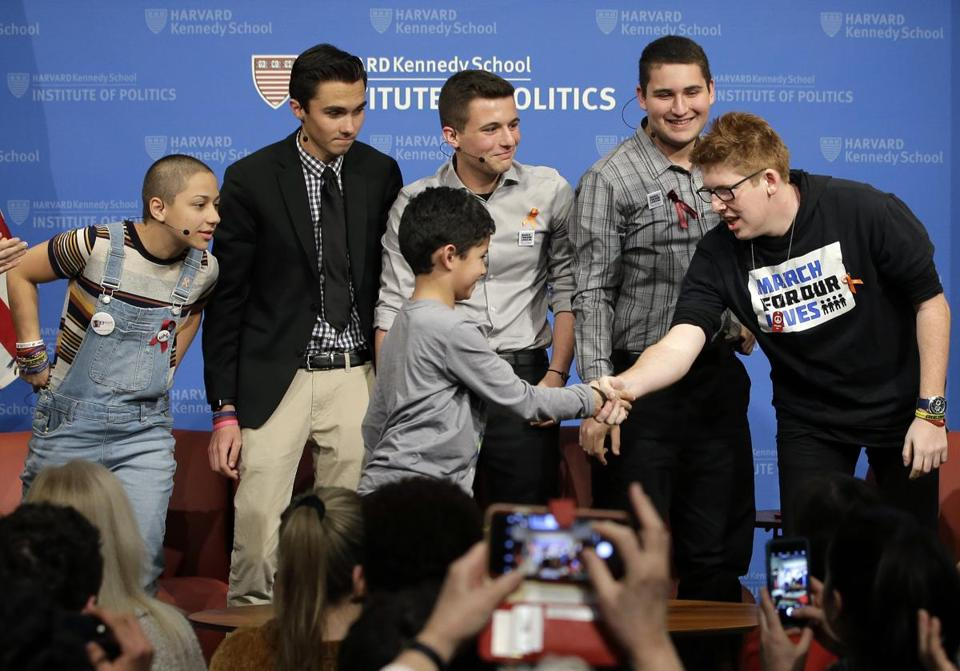 Noah King, 9, of Belmont stepped on stage to greet Marjory Stoneman Douglas High School students at Harvard on Tuesday.