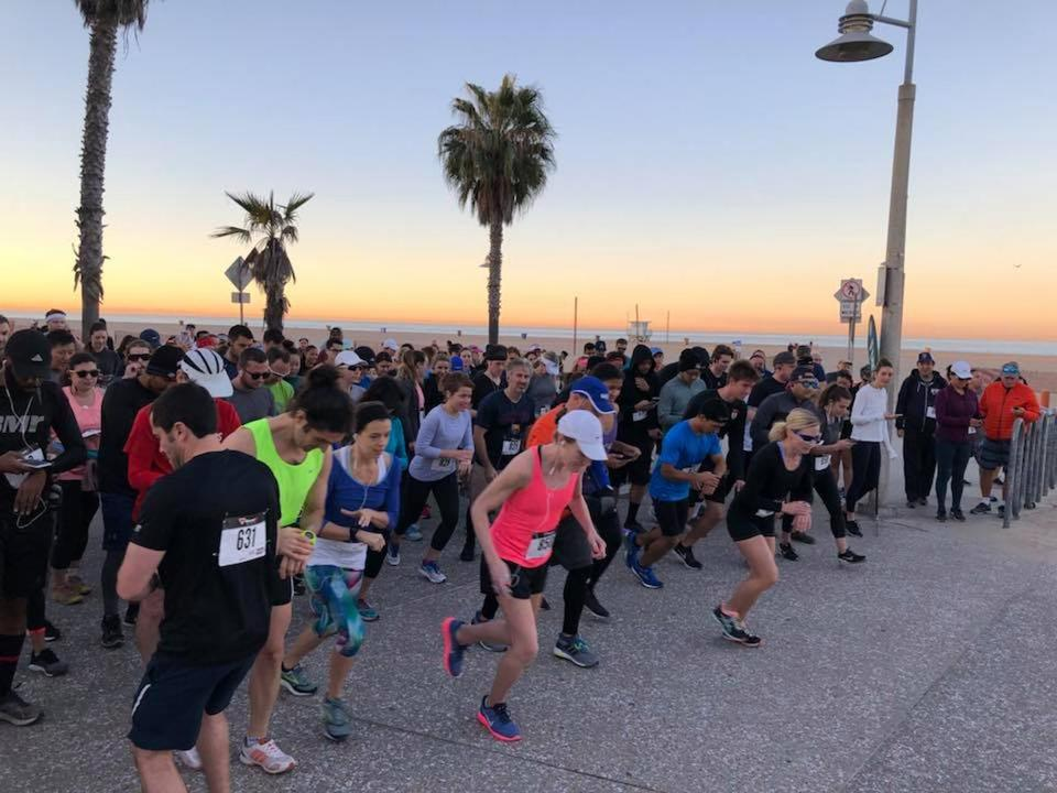 Loren Zitomersky (far left) starting a 10K race in Santa Monica, which he ran backward. He plans to run the Boston Marathon backward on April 16, 2018.
