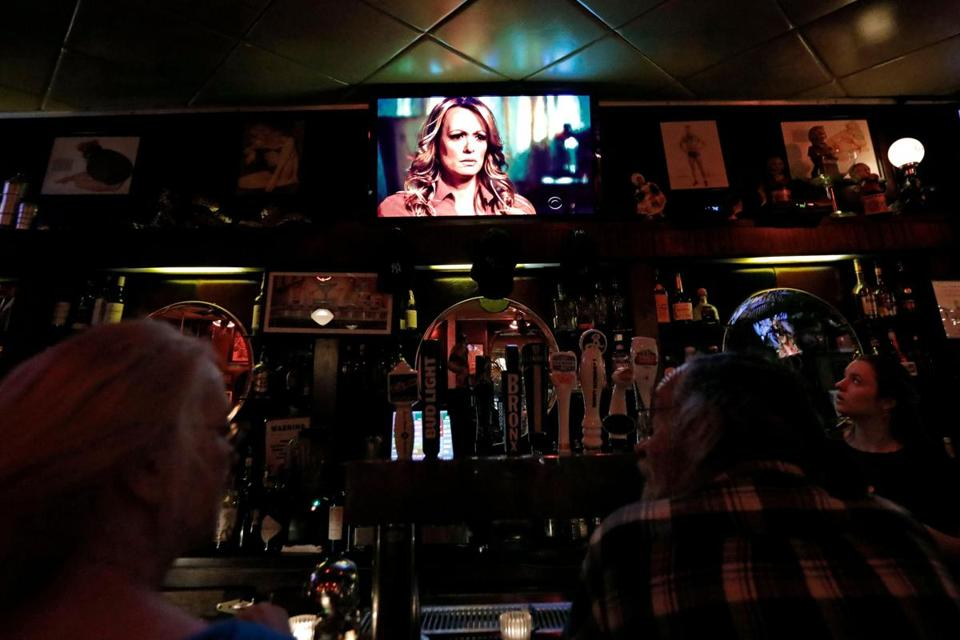 Patrons in a bar on Manhattan's Upper West Side were glued to the TVs as the interview aired.