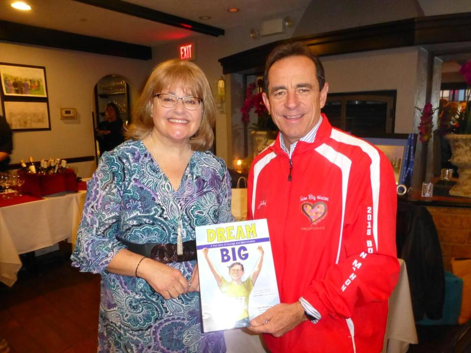 Coauthors Nancy Feehrer of Westford and Boston Marathon race director Dave McGillivray of North Andover.