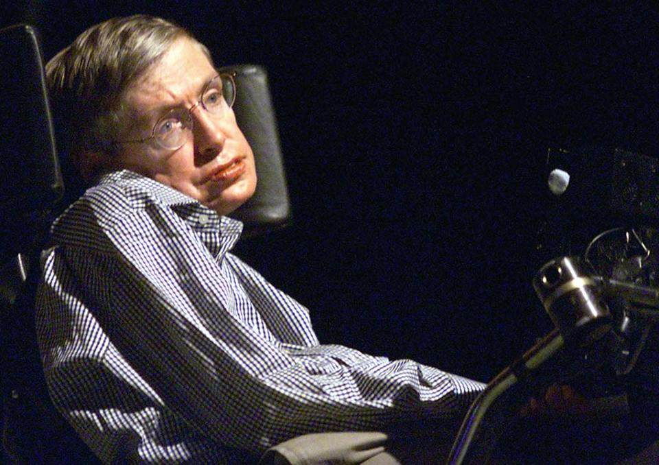 "(FILES) This file picture taken on August 18, 2002 shows Stephen Hawking, the world-renowned physicist, delivering his lecture in Beijing. Millions of Chinese mourned Stephen Hawking on March 14, 2018, bidding farewell to a ""giant star"" admired in China for stoically rising above physical disability and for reaching out to Chinese fans on social media. / AFP PHOTO / --/AFP/Getty Images"