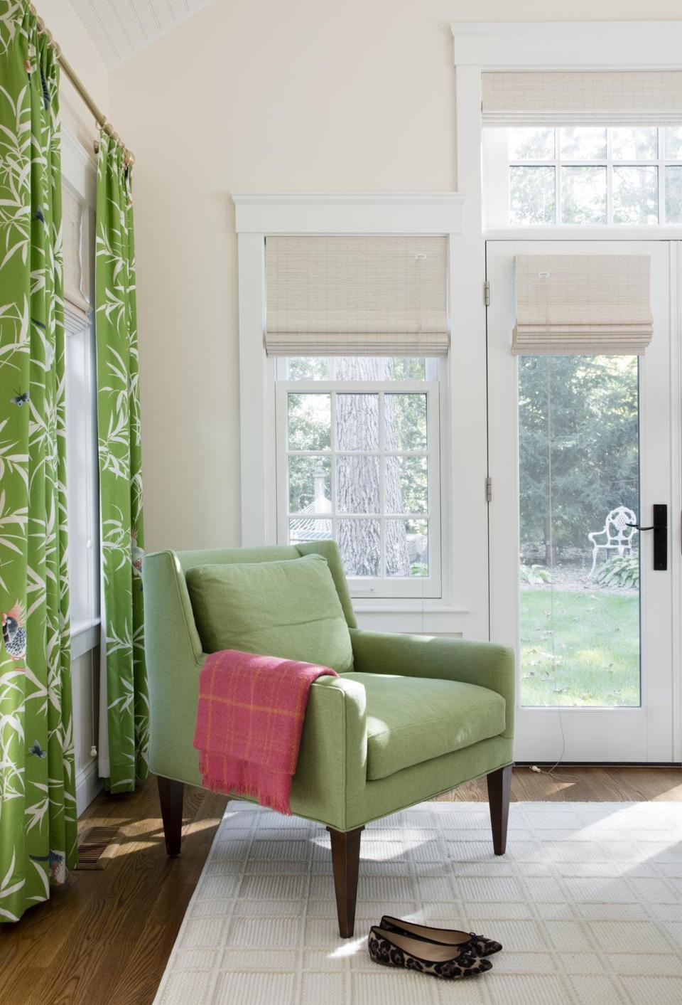 "The master bedroom drapery fabric featuring tropical birds is Bamboo Grove from Bob Collins & Sons. ""The neutral rug has a pattern that adds to the room, but not too much,"" Emily says."
