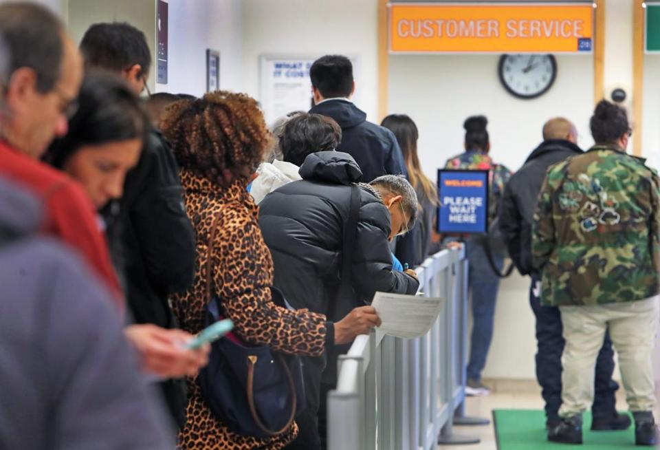 Customers waited in line Monday at the downtown Boston RMV office.