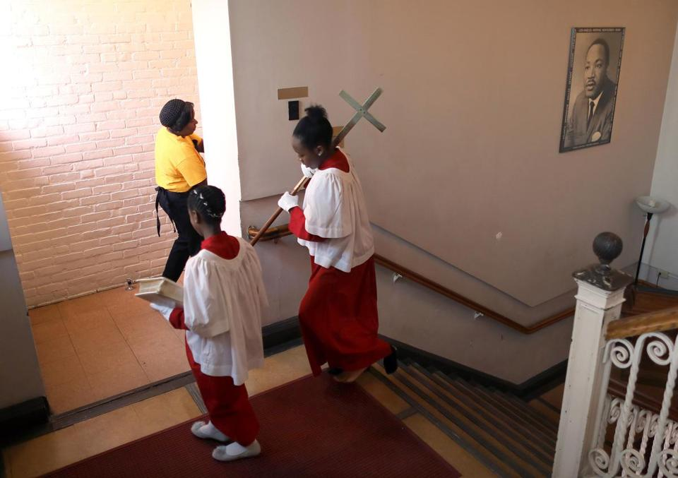 Acolytes Raeanna Harwood, 9, and Lauren Crockton, 13, headed up the stairs at the Twelfth Baptist Church, the Boston church home of Martin Luther King Jr.