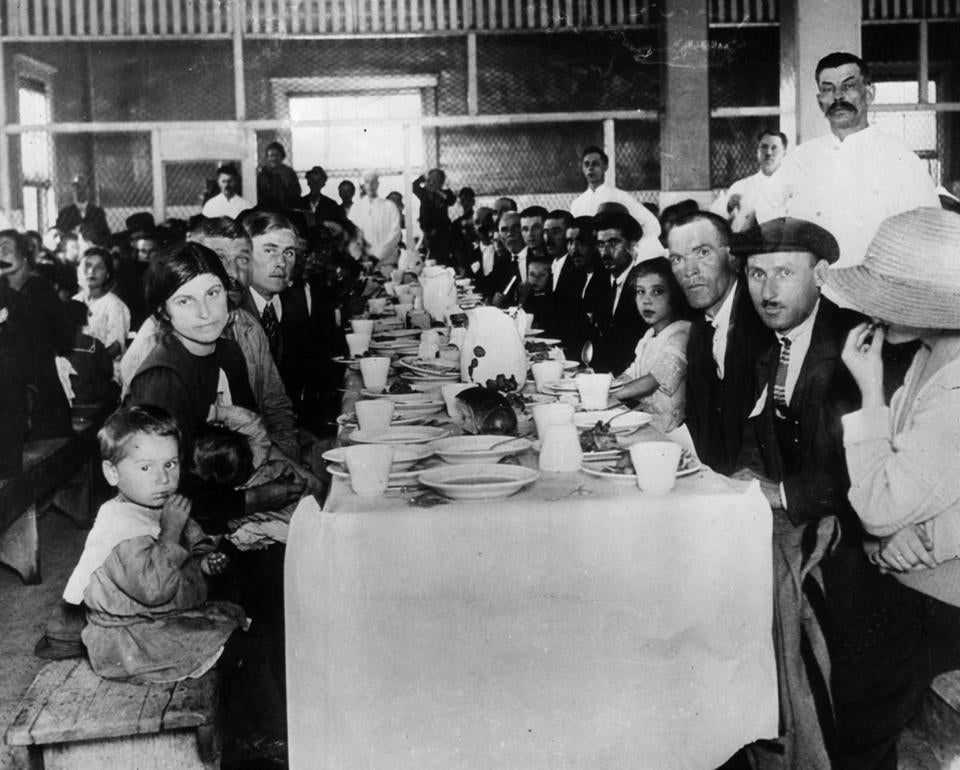 Immigrants having lunch at Ellis Island just before the First World War. Ellis Island received as many as 790,000 immigrants at this time. AP/Wide World