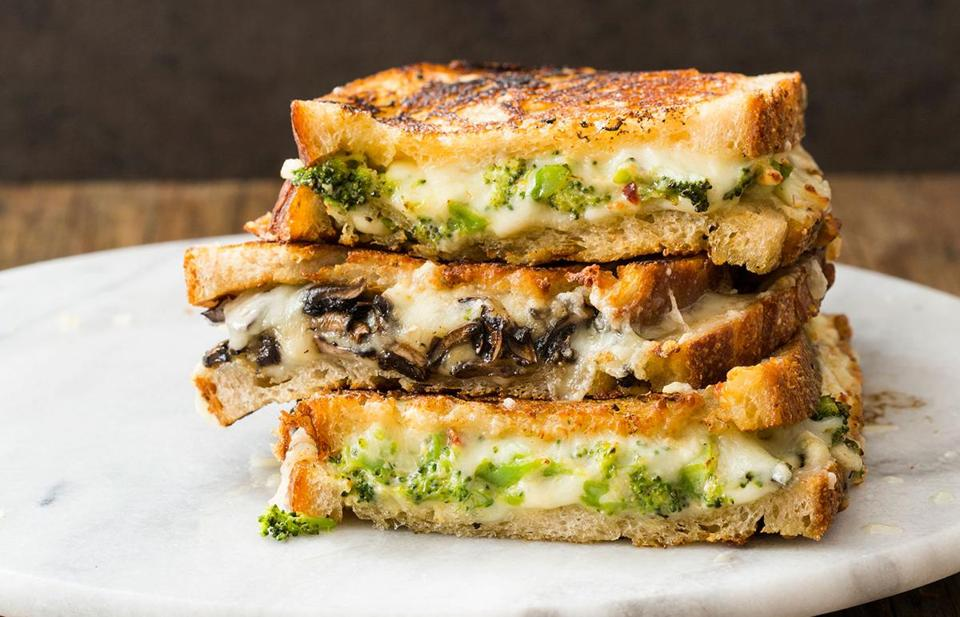 Broccoli alfredo and provolone grilled cheese sandwich (top and bottom); rosemary-mushroom and gruyere grilled cheese sandwich (middle).