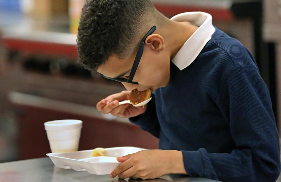 LAWRENCE, MA - 3/28/2018: Studnet Rayniel Lara samples his own cooking. Teaching kids to eat healthfully, fifth and sixth graders from the Guilmette Middle School in Lawrence attending a nutrition and cooking class, sponsored by Groundwork Lawrence at Lawrence Boys and Girls Club. (David L Ryan/Globe Staff ) SECTION: REGIONAL TOPIC 15onutritionnorth