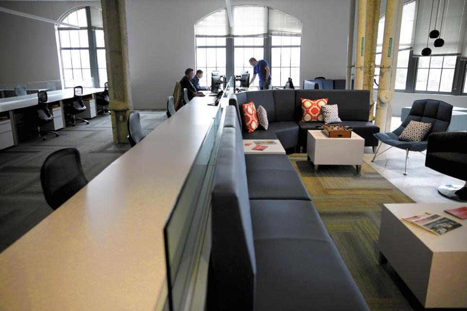 Office space abuts the common area at Janeiro Digital in Boston.