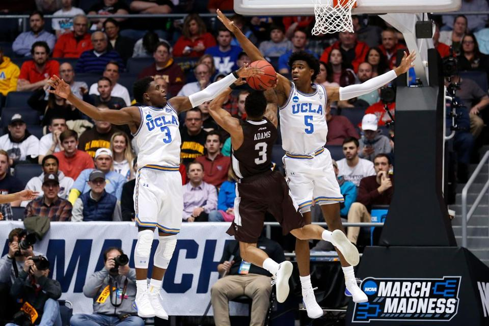 Jaylen Adams of St. Bonaventure attempted a shot under pressure from Chris Smith and Aaron Holiday of UCLA during a March 13 tournament game.