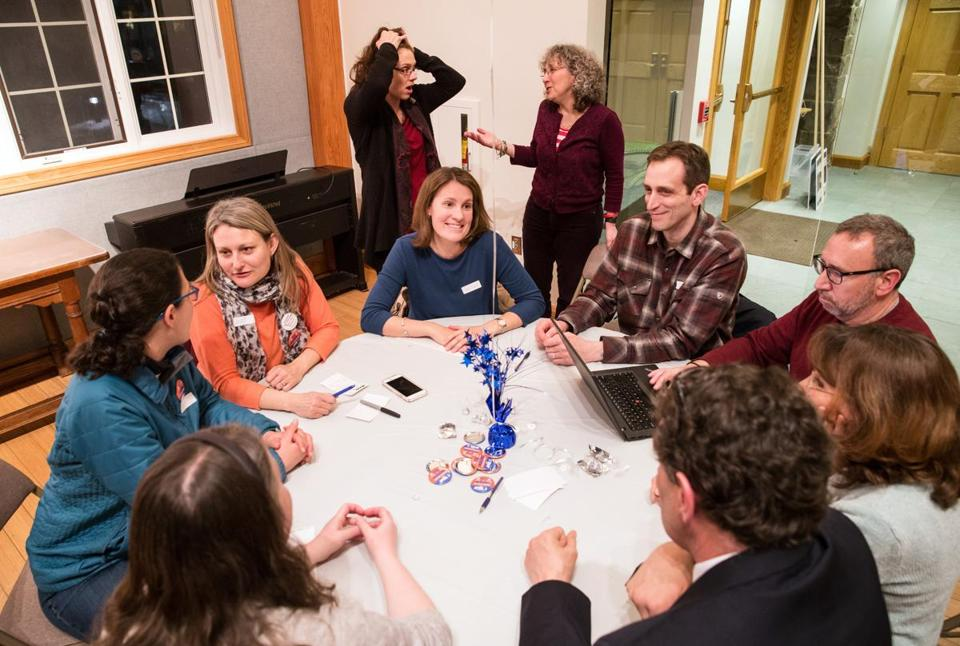 Members of the group Yes for Reading consulted last month during a meeting at the Unitarian Universalist Church.