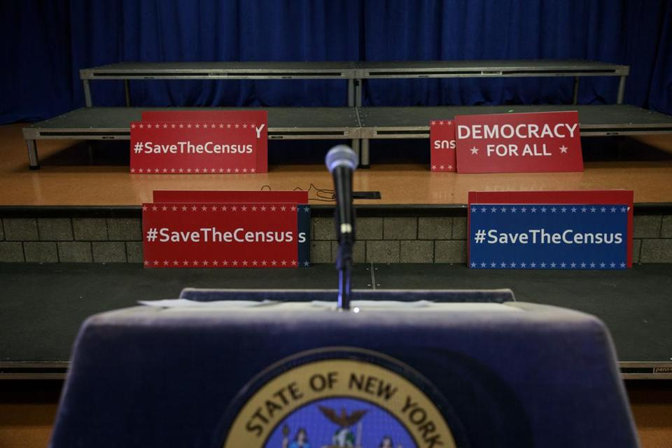 Signs behind the podium before a press conference on Tuesday with New York Attorney General Eric Schneiderman to announce a multi-state lawsuit to block the Trump administration from adding a question about citizenship to the 2020 Census form.