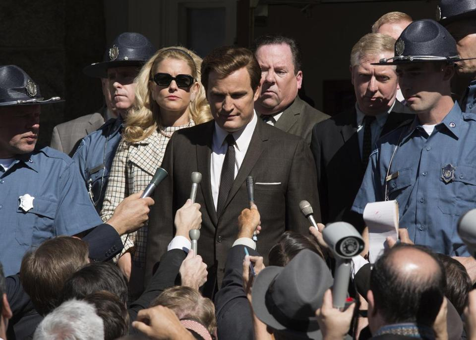 "This image released by Entertainment Studios shows Jason Clarke as Ted Kennedy, center, and Andria Blackman stars as Joan Kennedy in a scene from ""Chappaquiddick."""